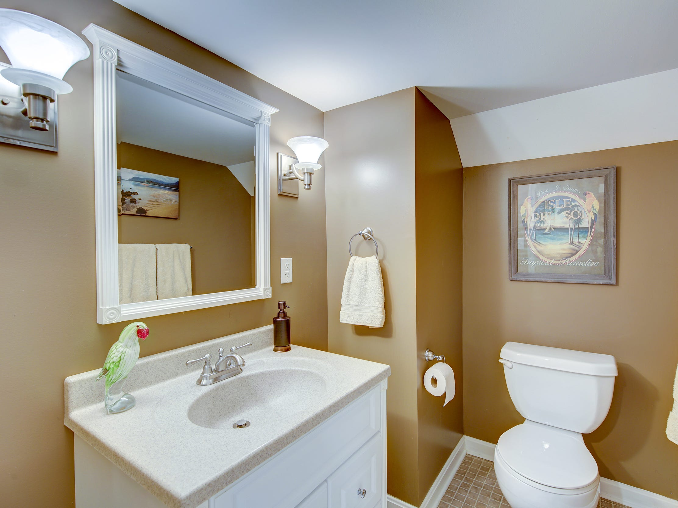 The house at 204 Lakeview Shores at Rehoboth Beach has four full bathrooms and two half baths.
