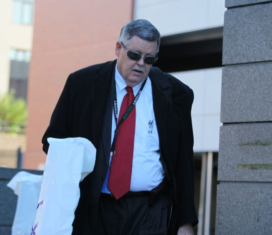 Deputy Attorney General John Downs walks into the New Castle County Courthouse.