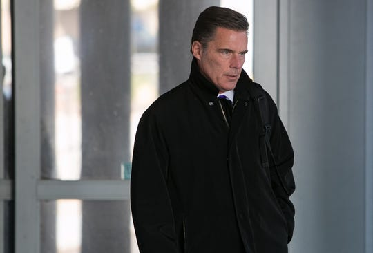 Defense Attorney Patrick Collins leaves the Leonard Williams Justice Center after opening statements in murder trials tied to the riot at James T. Vaughn Correctional Center in Wilmington.
