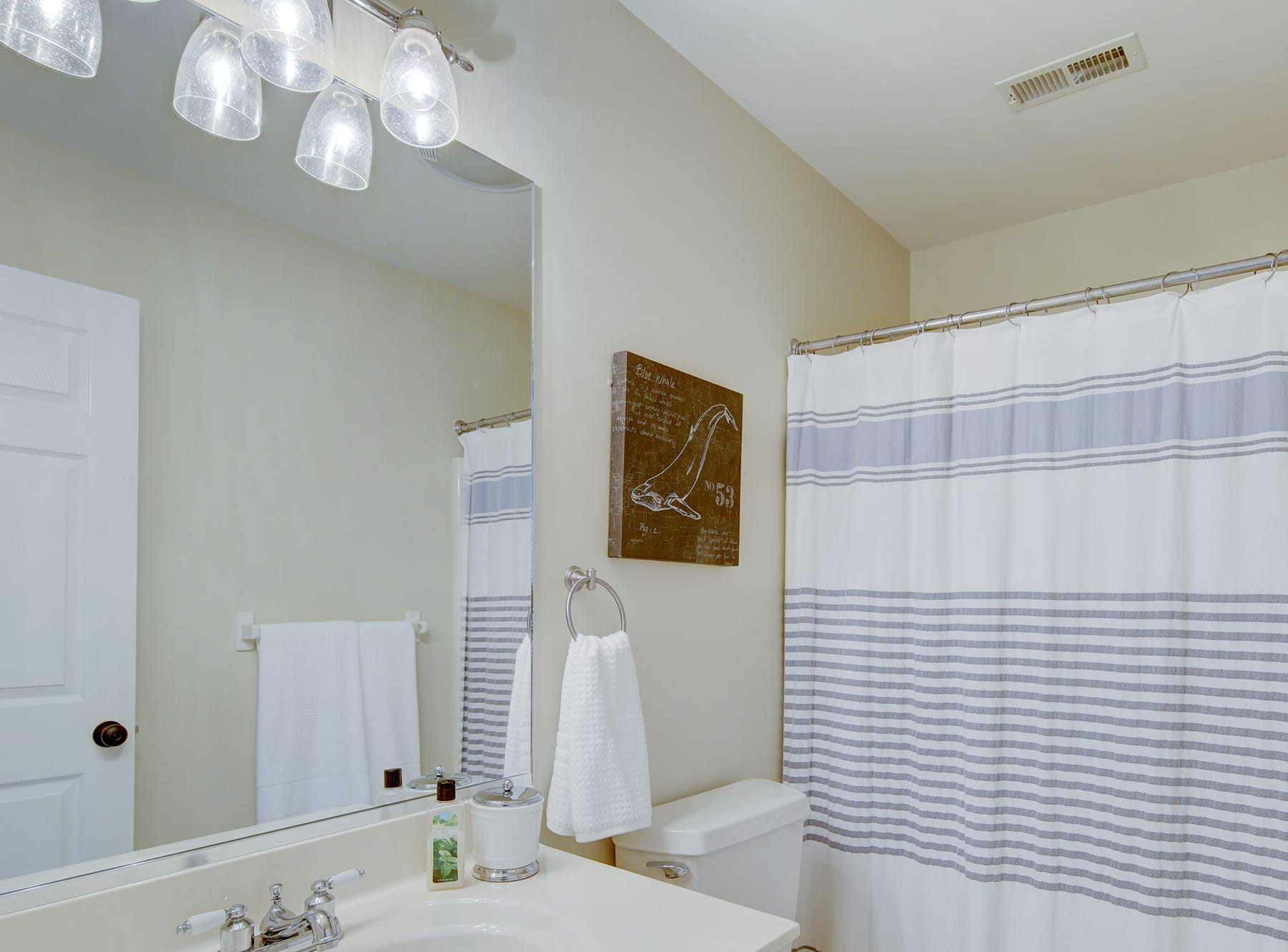 The house at 204 Lakeview Shores features four full bathrooms and two half baths.