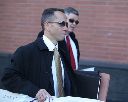 Deputy Attorney generals Brian Robertson (foreground) and John Downs walk into the New Castle Courthouse.