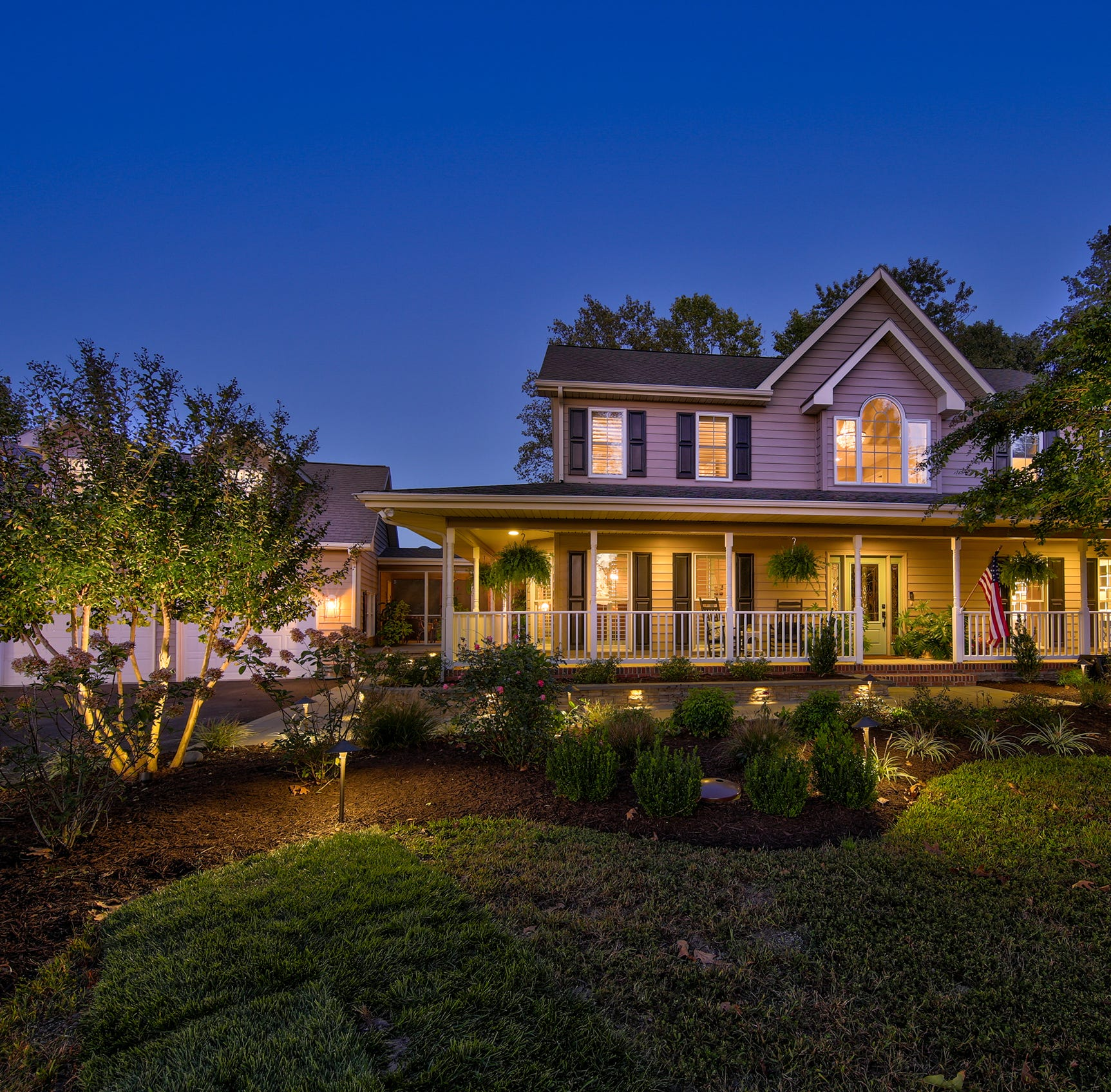 Huge rooms, porch, tiered decks make this Rehoboth house perfect for entertaining