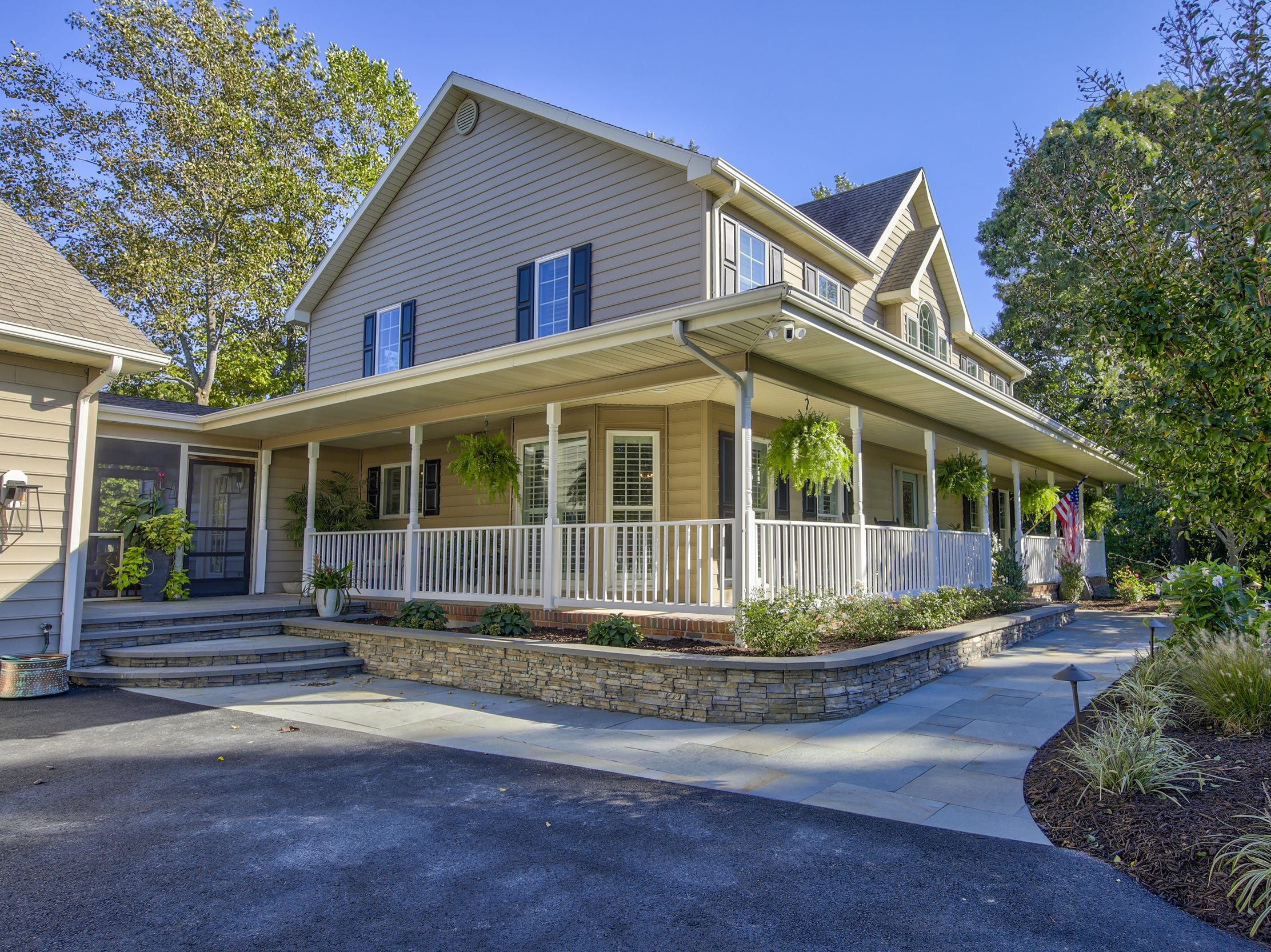 This 5,000-square-foot home at 204 Lakeview Shores in The Glade at  Rehoboth Beach features a front porch and landscaping.