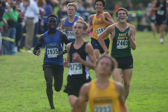 Cross country is one of the most grueling high school sports, as seen here at the finish of last year's Joe O'Neill Invitational at Bellevue State Park.