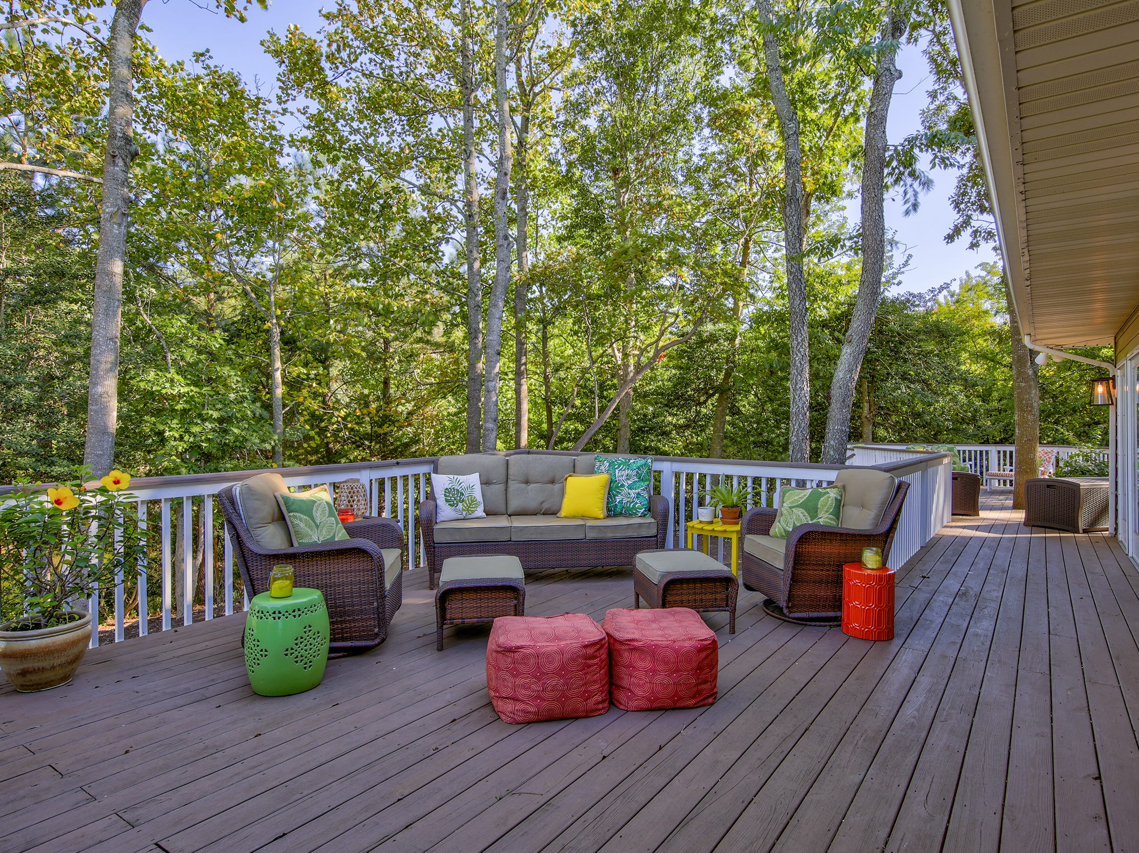 The rear deck at 204 Lakeview Shores in Rehoboth Beach overlooks a pond.