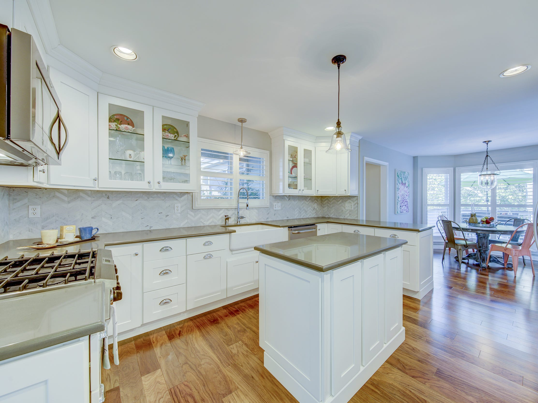 The chef's kitchen at 204 Lakeview Shores has white custom cabinets and quartz countertops.