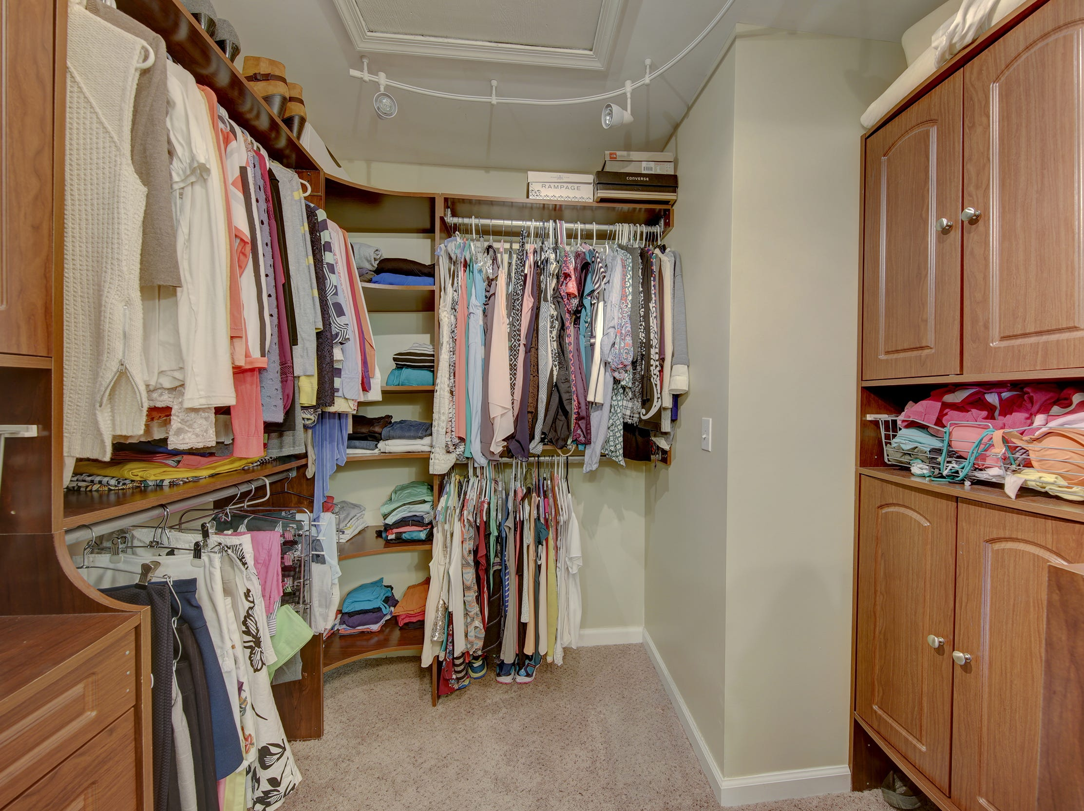 A custom walk-in closet at 204 Lakeview Shores in Rehoboth Beach offers specialized storage.