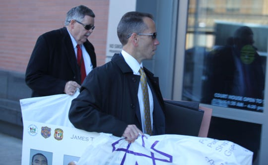 Prosecutors Brian Robertson (foreground) and John Downs (background) enter the New Castle Courthouse.