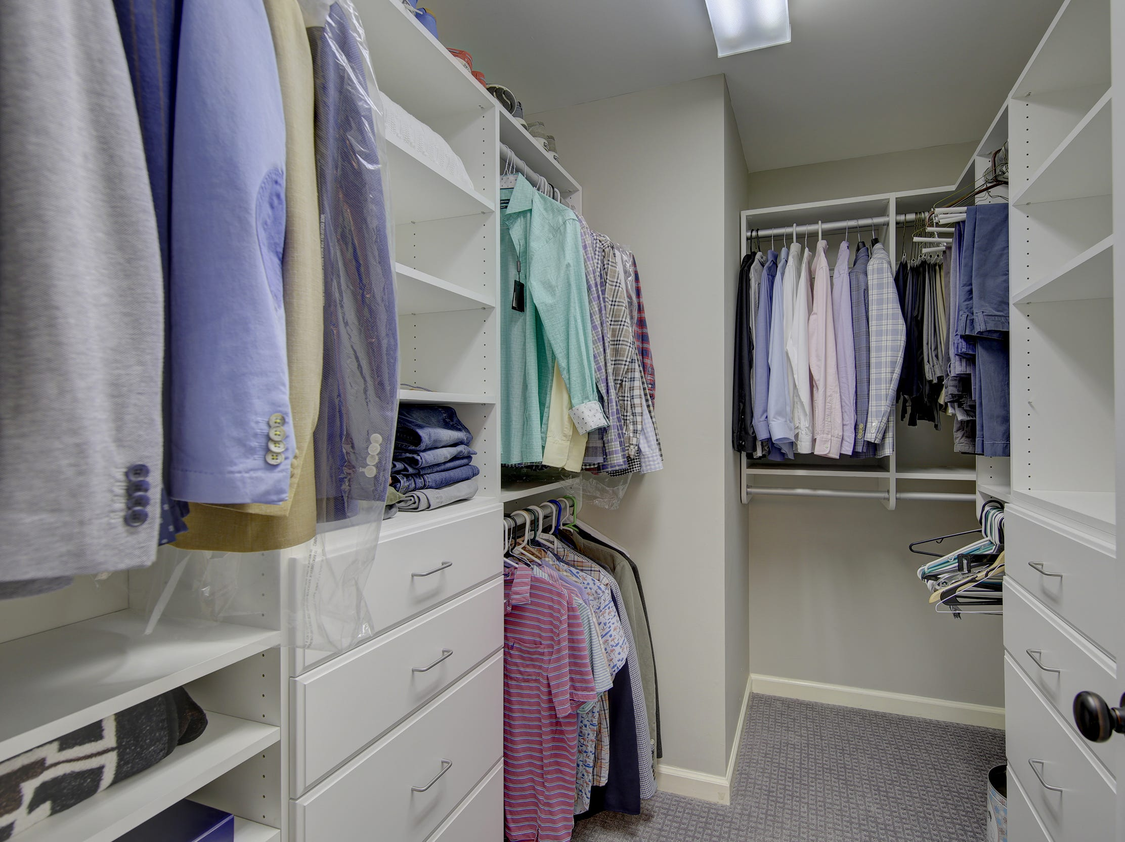 A custom walk-in closet at 204 Lakeview Shores offers specialized storage.