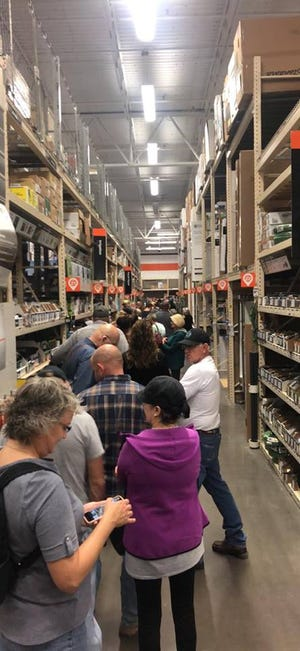 The line to vote at Home Depot in Wichita Falls reportedly wrapped around two long aisles at various times. A lunchtime crowd waited to cast their ballots on the first day of early voting for the Nov. 6 election