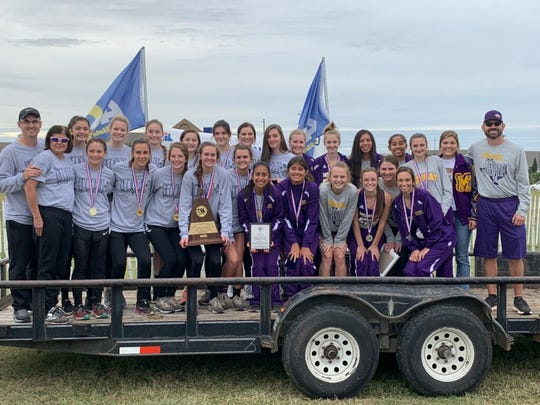The Benjamin (left) and Munday girls cross country teams went 1-2 Monday at regionals
