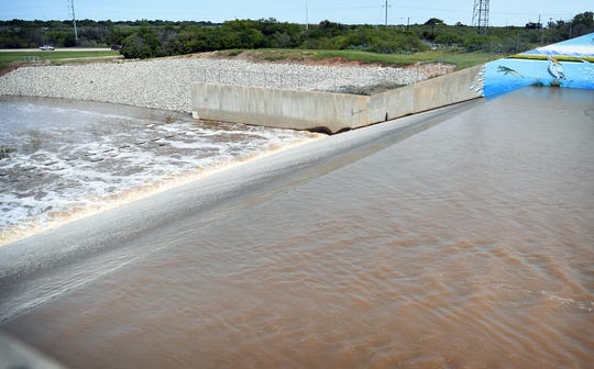 Water from a full Lake Wichita breaks over the edge of the spillway located in the northeast area of the lake. Area lakes are full withrecent  higher-than-normal rainfall amounts.