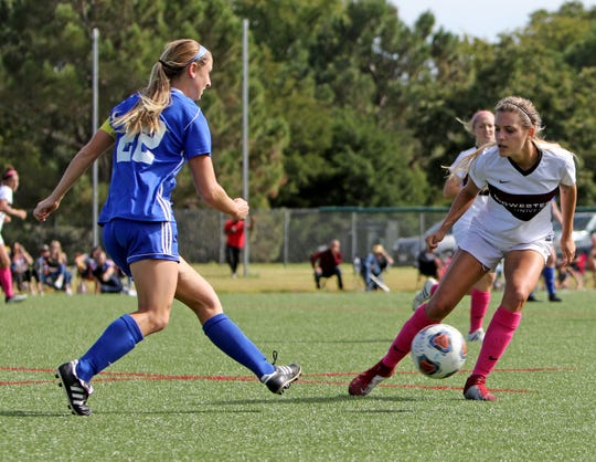 Angelo State's Megan Allen passes by Midwestern State's Emma Baley Sunday, Oct. 21, 2018, at the MSU soccer practice field.