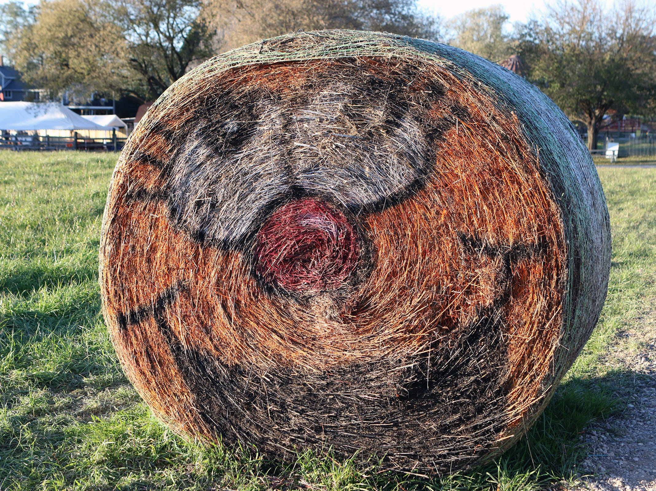 Faces painted on round bales greet visitors at Schuett Farms in Mukwonago.