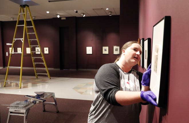 Sarah Franklin, exhibition manager at the Zanesville Museum of Art, hangs a piece for the upcoming exhibition of Rembrandt etchings. The piece, part of a show called Rembrandt, The Consumate Etcher and Other 17th Century Printmakers, opens with a free event on Thursday from 5:30 to 7:30.