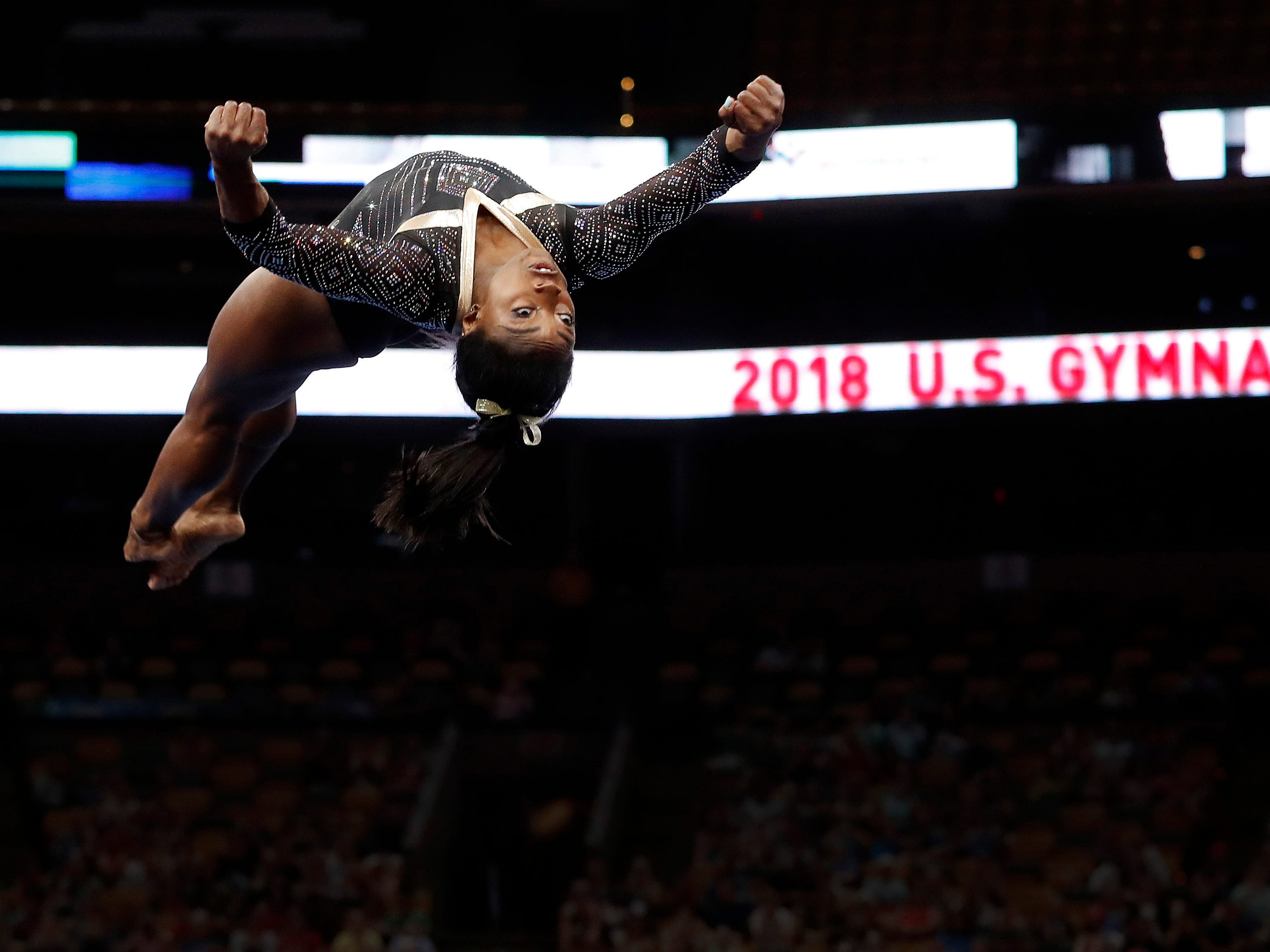Simone Biles competes in the floor exercise during the U.S. Gymnastics Championships at TD Garden on Aug. 17, 2018.