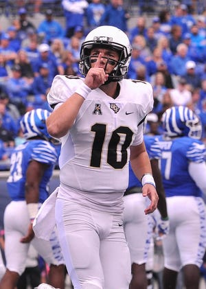 UCF Knights quarterback McKenzie Milton (10) reacts during the first half against the Memphis Tigers at Liberty Bowl Memorial Stadium.