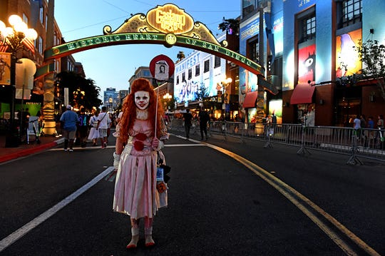 SAN DIEGO, CA - JULY 18: Anna Niebla, of San Diego, cosplays as Pennywise from Steven King's IT, in the Gaslamp District during Preview Night during the San Diego Comic-Con at the San Diego Convention Center in San Diego on Wednesday, July 18, 2018.(Photo by KJennifer Cappuccio Maher/Inland Valley Daily Bulletin via Getty Images)