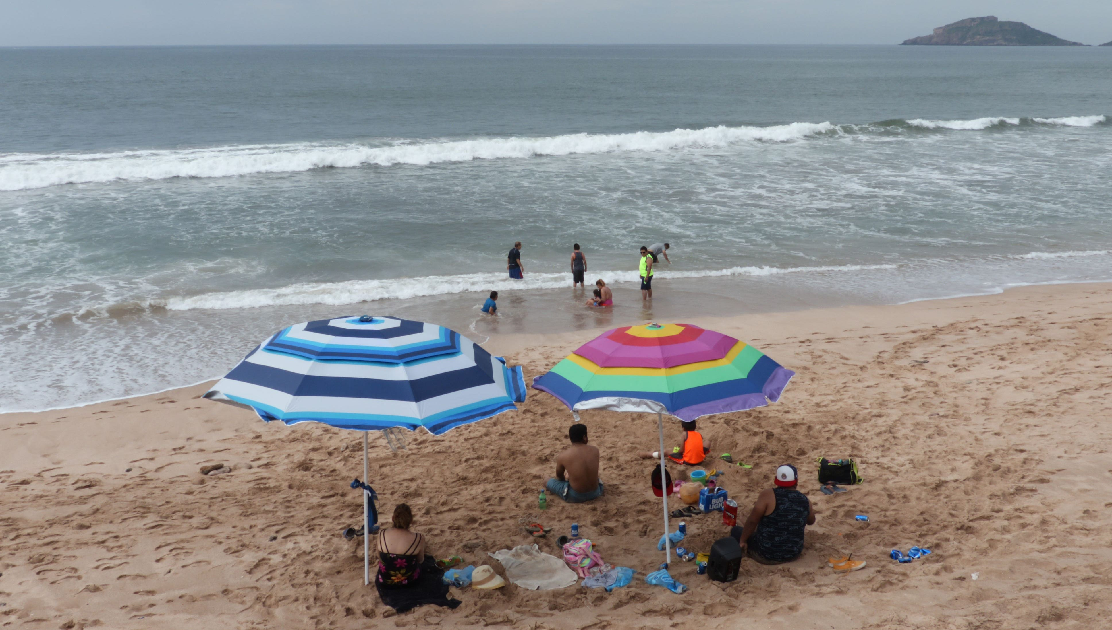 Tourists on Sunday enjoy the beach in Mazatlan, in Mexico's Sinaloa state, where Hurricane Willa is expected to land Tuesday.