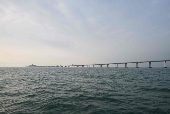 A general view shows the Hong Kong-Zhuhai-Macau Bridge (HKZM) (back) in Hong Kong on October 22, 2018. The world's longest sea-bridge connecting Hong Kong, Macau and mainland China will be launched October 23, at a time when Beijing seeks to tighten its grip on its territories.