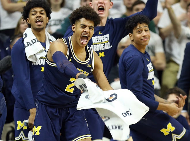 Michigan Wolverines guard Jordan Poole (2) celebrates during the second half of a game against the Michigan State Spartans at Jack Breslin Student Events Center.