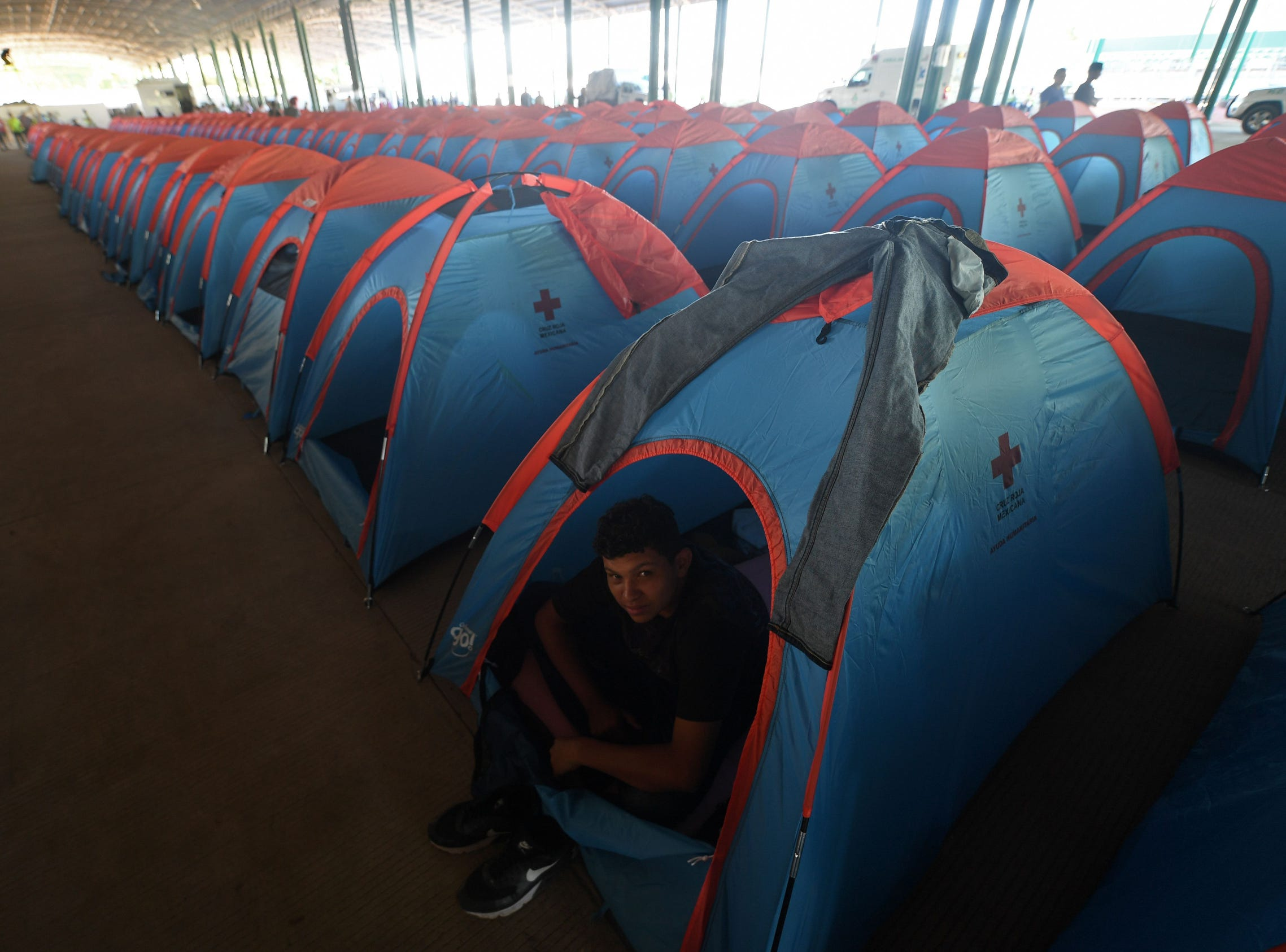 A mirant rests in a tent at the International Mesoamerican Fair's venue in Tapachula, Chiapas state, Mexico.