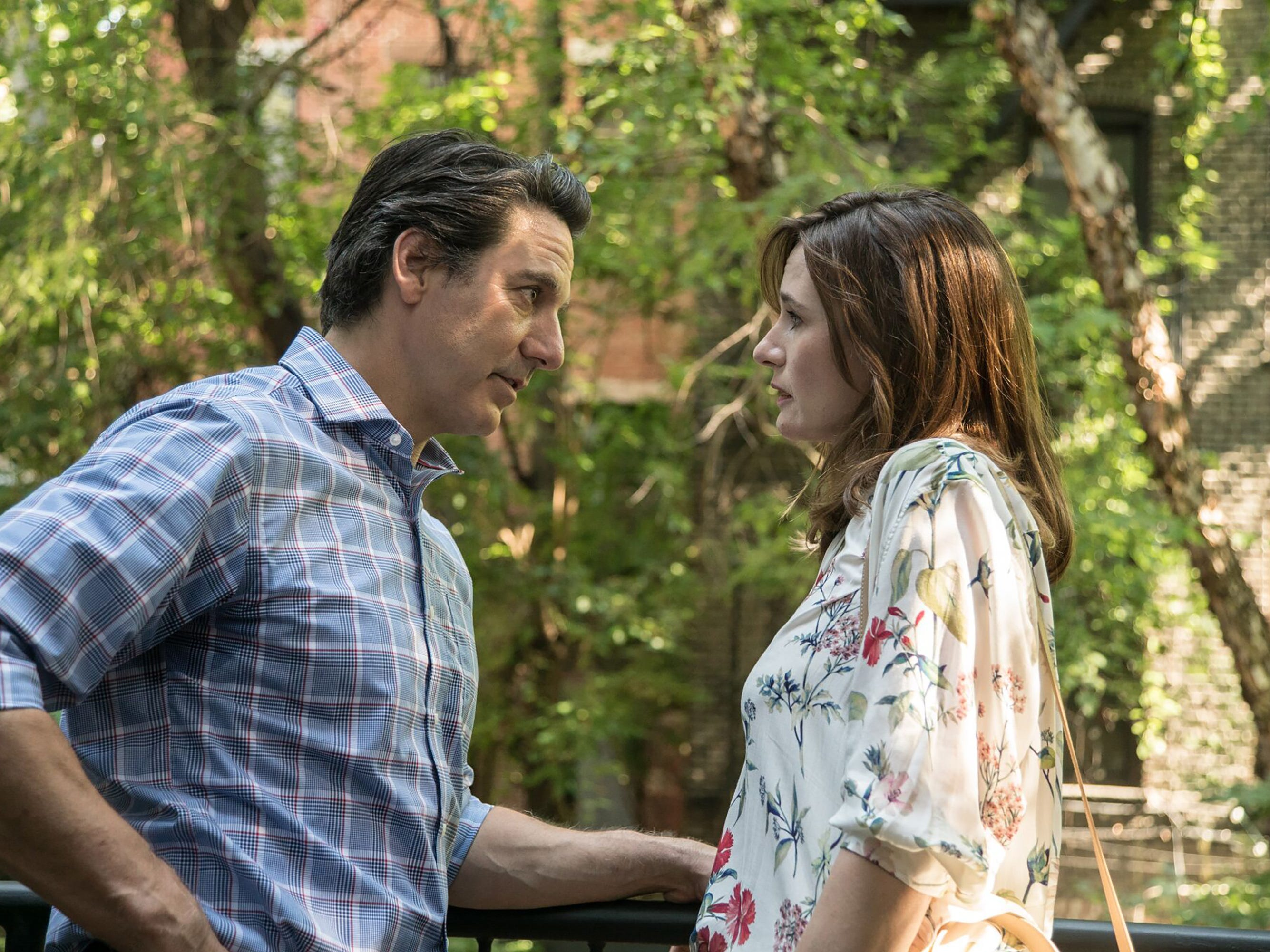 "Emily Mortimer (right, with Scott Cohen) is a clueless member of New York's Upper East Side elite in the romantic comedy ""Write When You Get Work."""