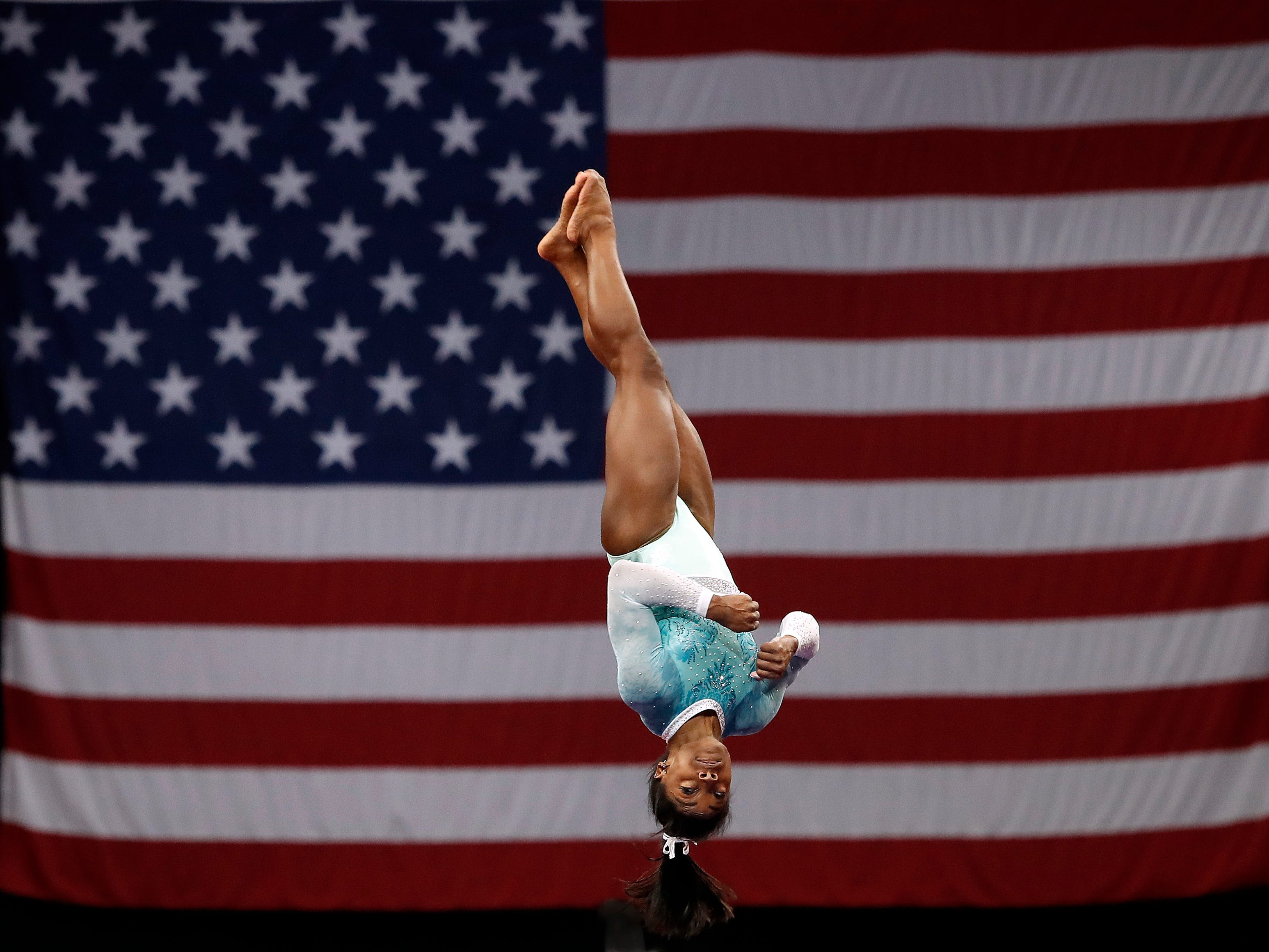 In 2018, Simone Biles competes on the vault during the U.S. Gymnastics Championships at TD Garden in Boston.