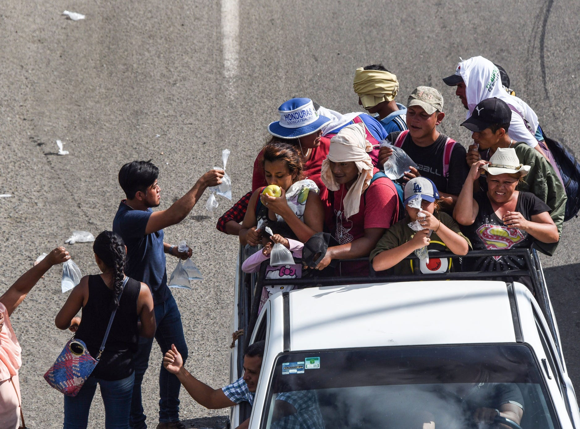 Migrants packed in the bed of a truck take part in a caravan heading to the US, near Huehuetan, on their way from Tapachula to Huixtla, Chiapas state, Mexico.