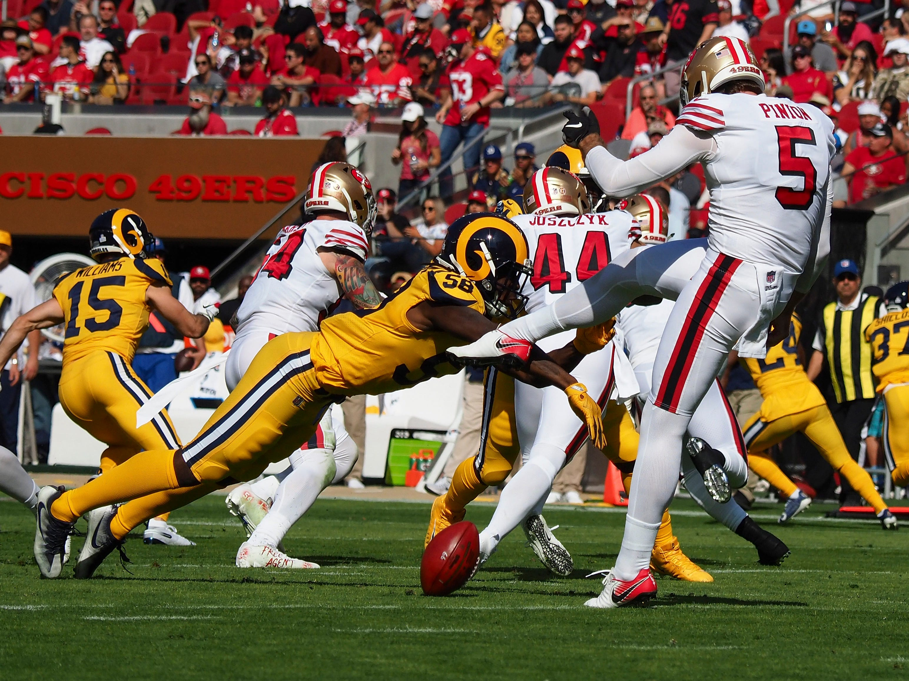 Week 7: Los Angeles Rams linebacker Cory Littleton blocks a punt by San Francisco 49ers punter Bradley Pinion during the second quarter at Levi's Stadium. The Rams won the game, 39-10.