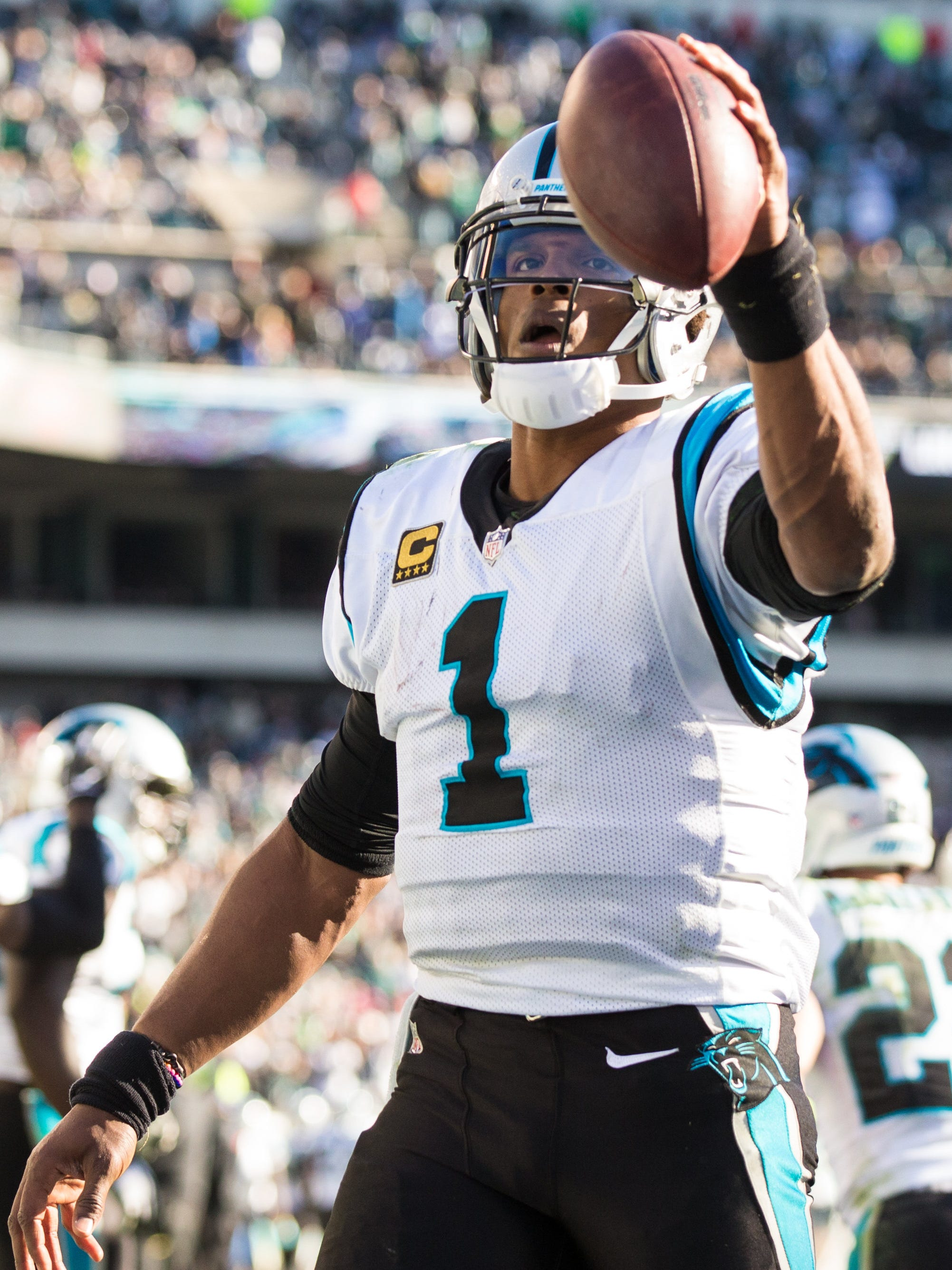 Cam Newton celebrates his touchdown pass to tight end Greg Olsen against the Eagles.