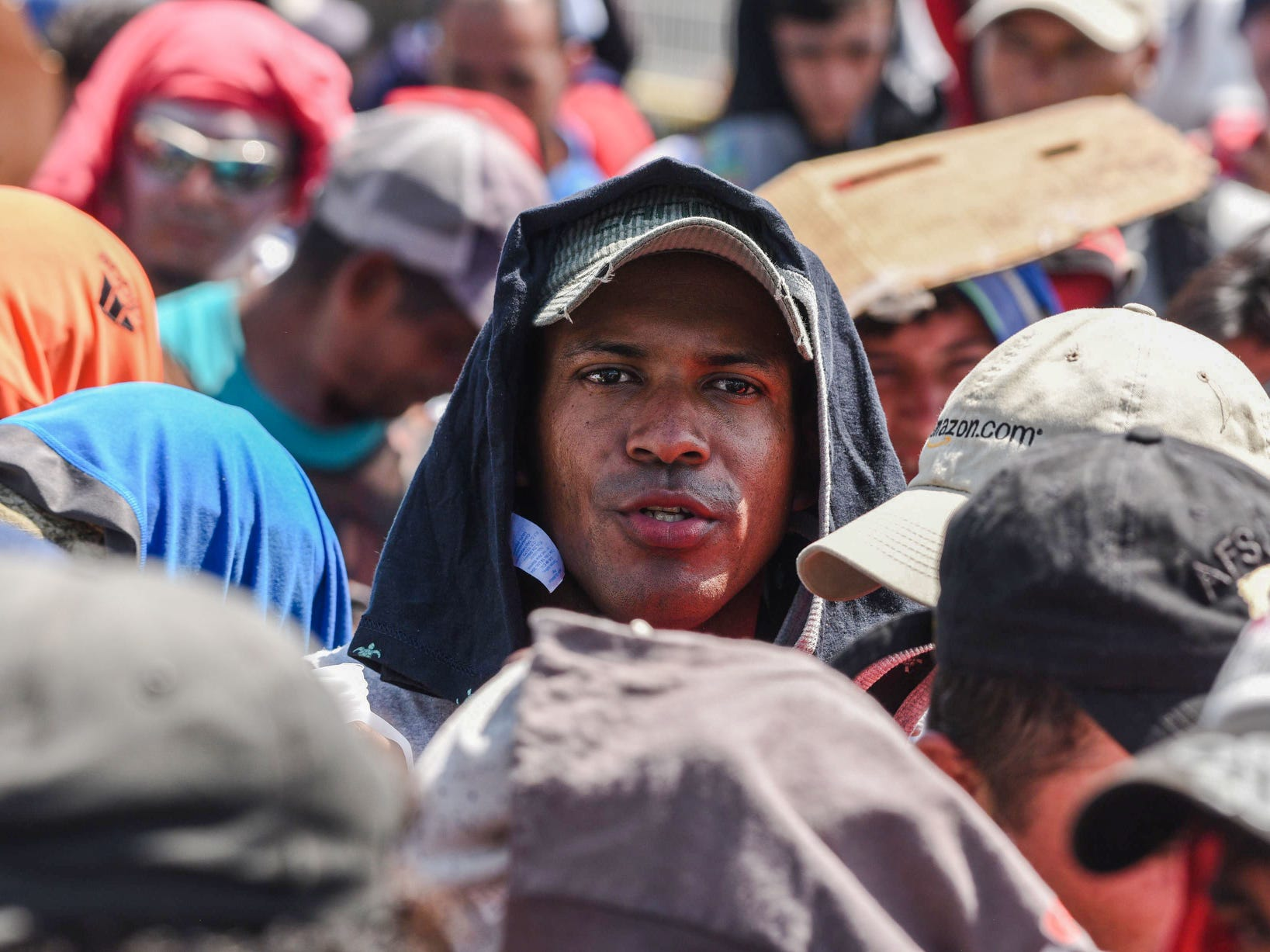 Migrants to the wait to cross the border from Ciudad Tecun Uman in Guatemala, to Ciudad Hidalgo, Mexico, Monday.