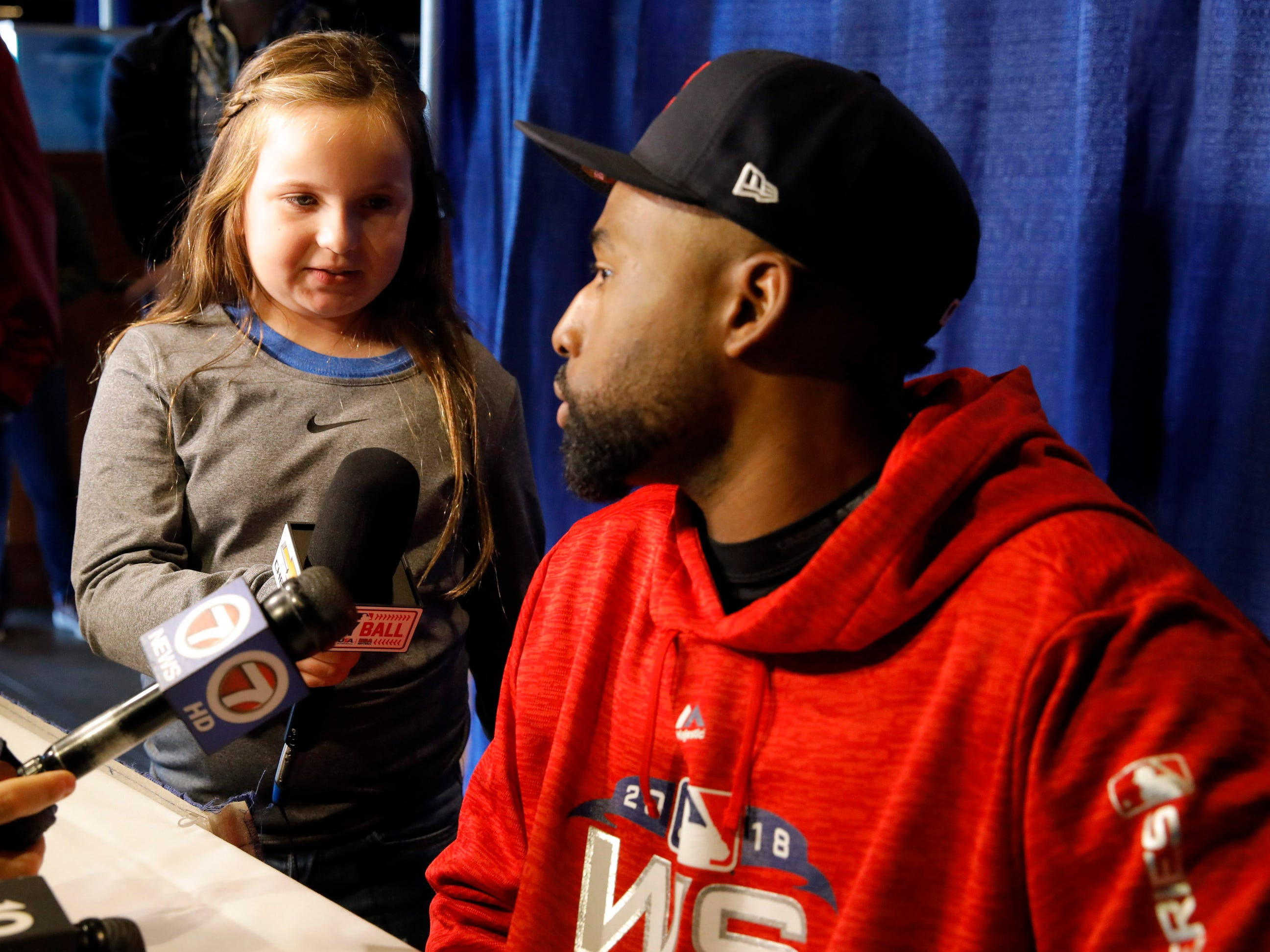 A young reporter Lucy Calhoun, 8 years old from Arkansas, interviews Red Sox center fielder Jackie Bradley Jr.