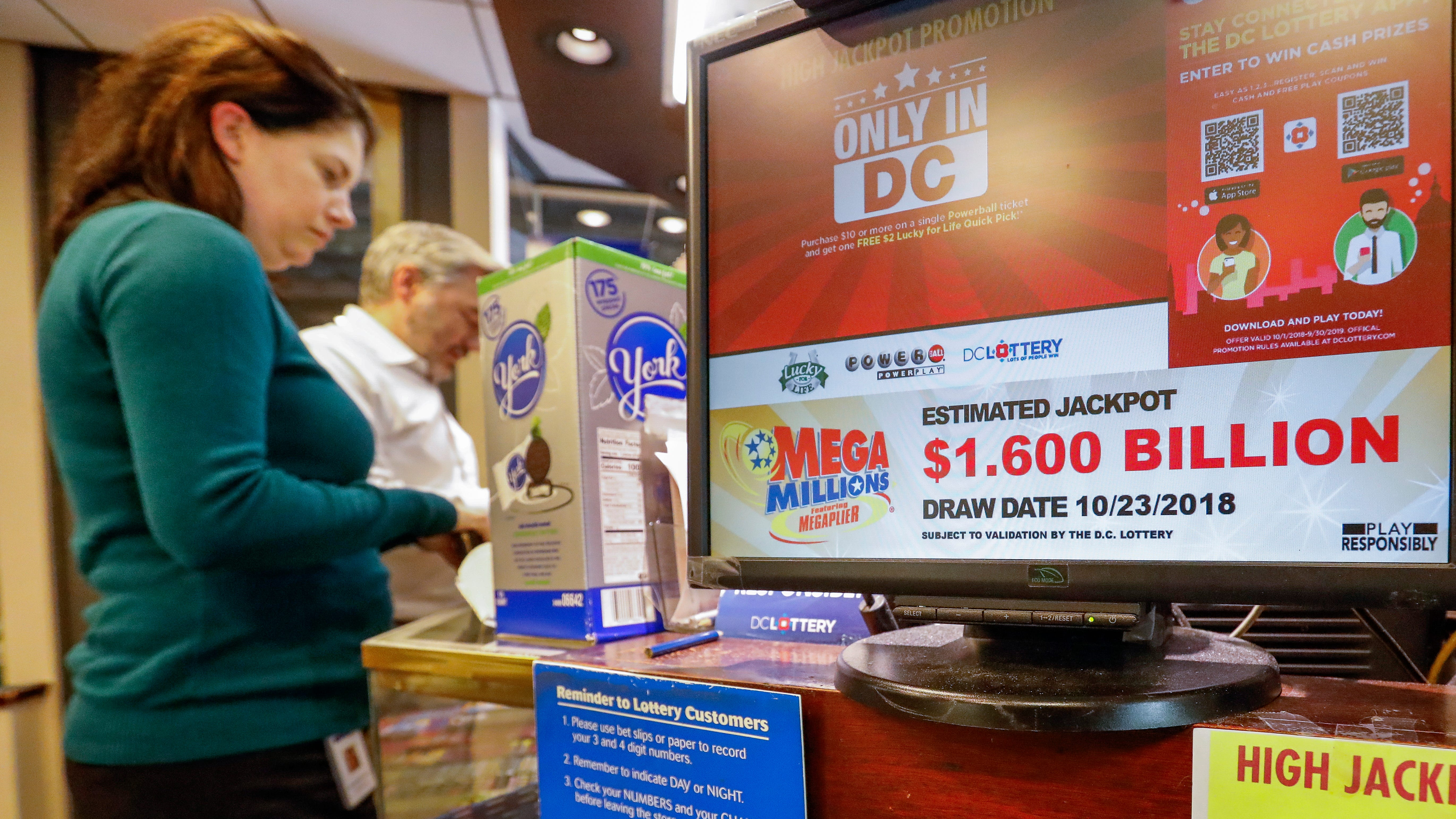 Customers purchase Mega Millions lottery tickets in Washington, D.C., Oct. 22, 2018.