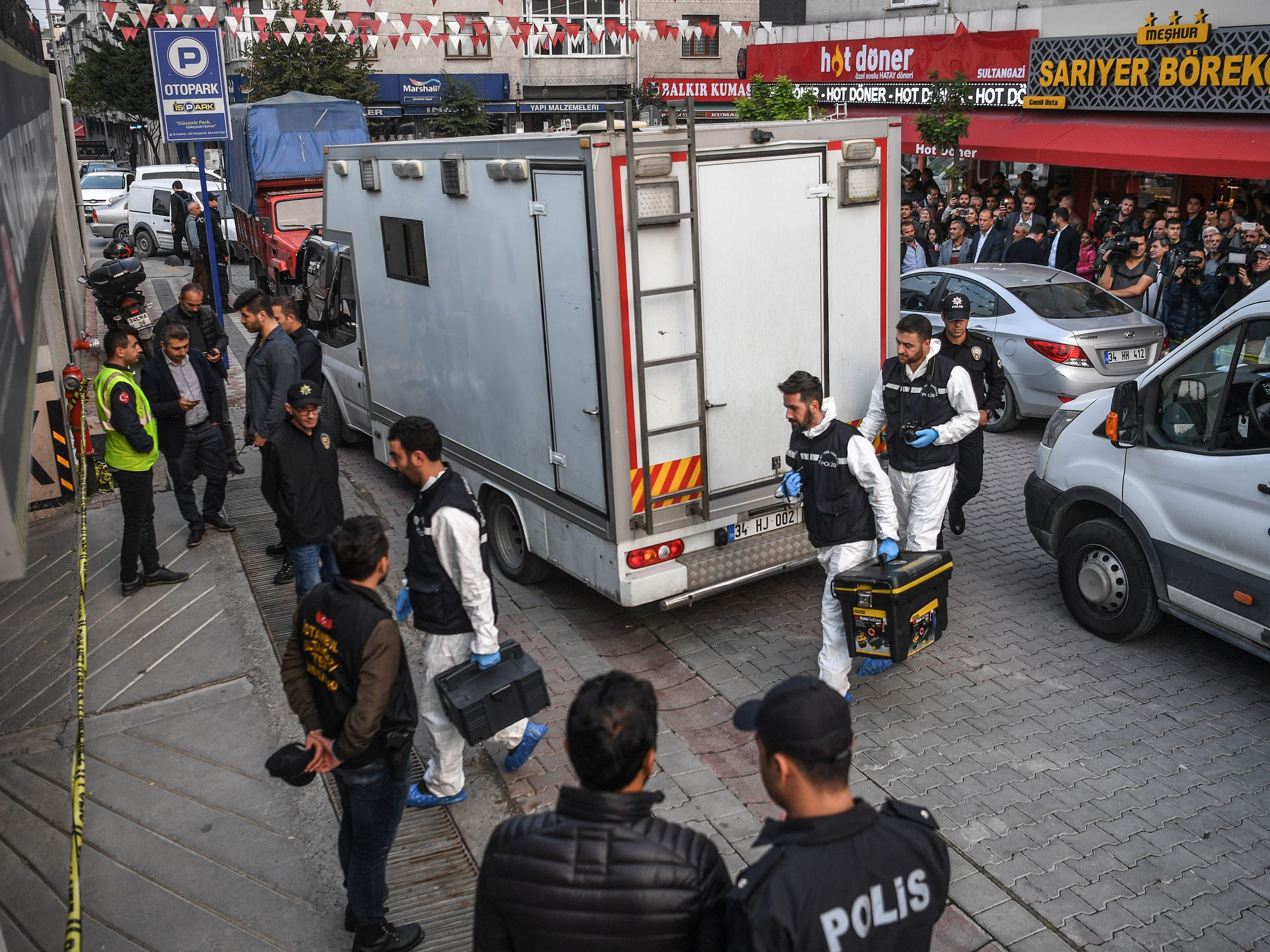 Turkish forensics arrive at an underground car park cordoned off by Turkish police, Oct. 22, 2018 in Istanbul, after they found an abandoned car belonging to the Saudi consulate, three weeks after the murder of journalist Jamal Khashoggi in the Saudi consulate.