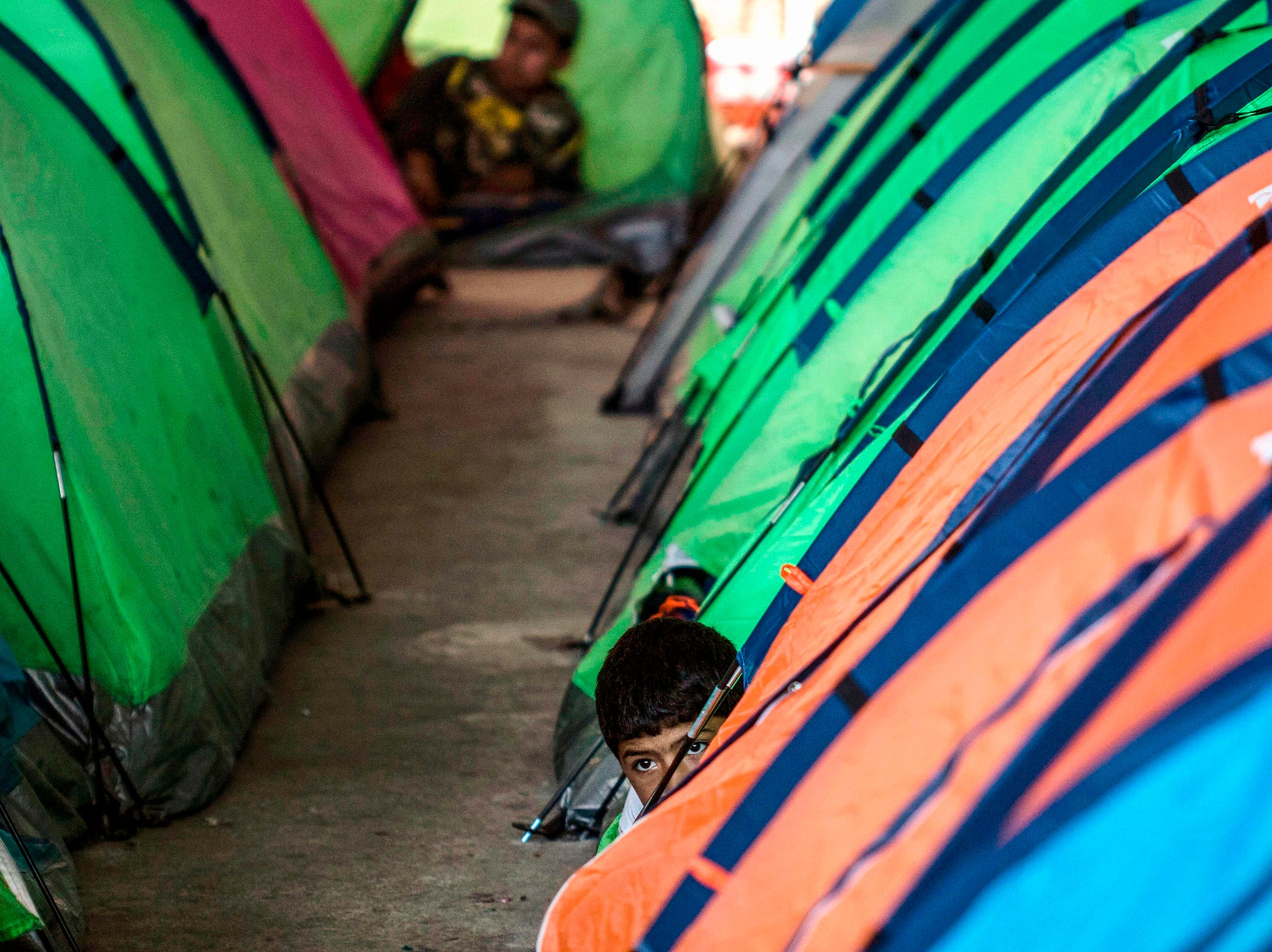 A Mexican migrant boy remains next to tents at a shelter in Tijuana, Baja California state, Mexico, in the border with the US.