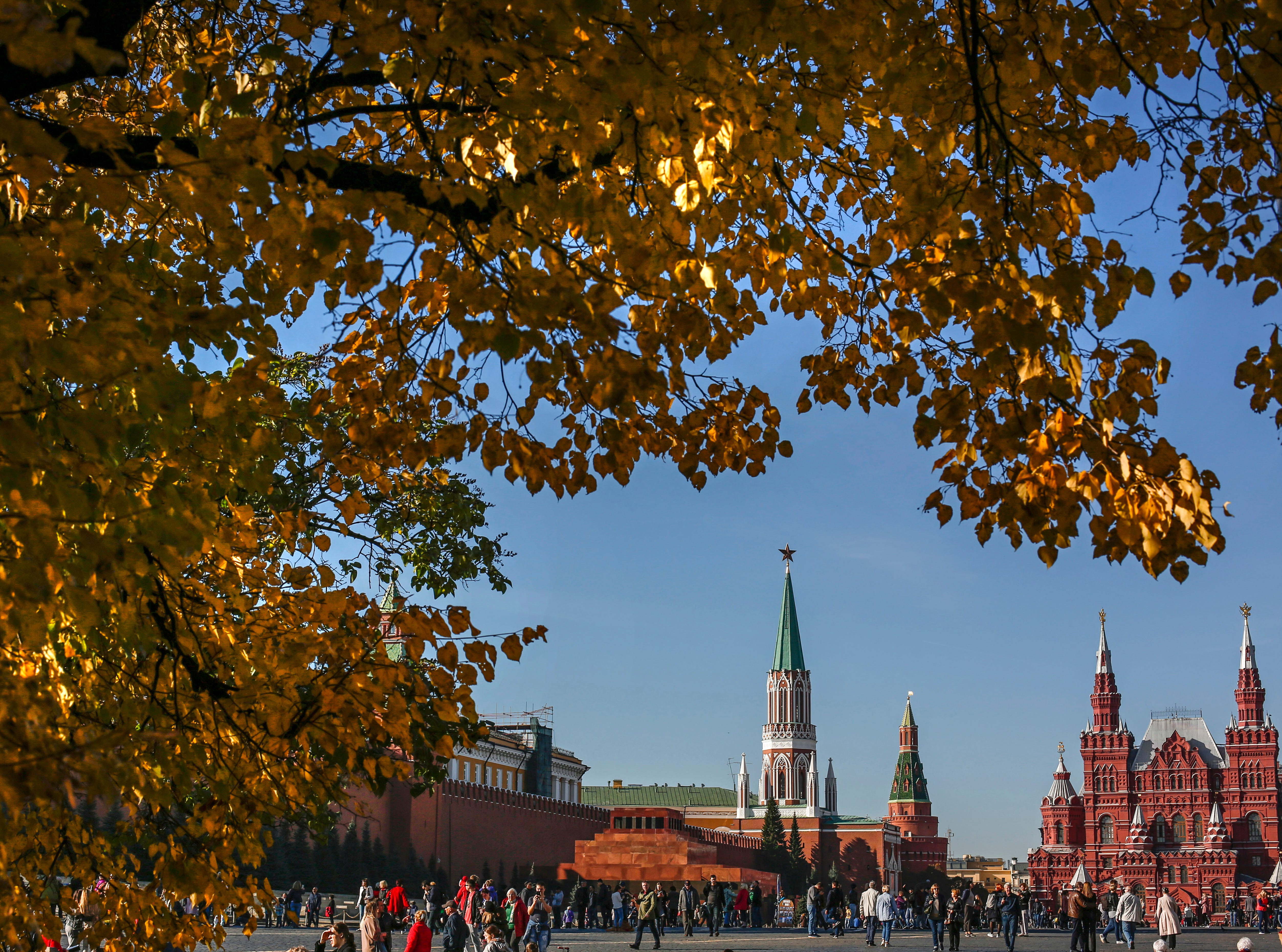 People walk on Red Square on a sunny and warm day in Moscow, Russia on Oct. 16, 2018.