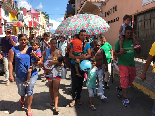 Gerson Monterosa, 32, (with umbrella) USA TODAY that he, his wife and three young children, including a two-month old baby, were determined to get to the United States to escape the lawlessness that plagues the country of his birth. He was in the city Tepachula on Monday.
