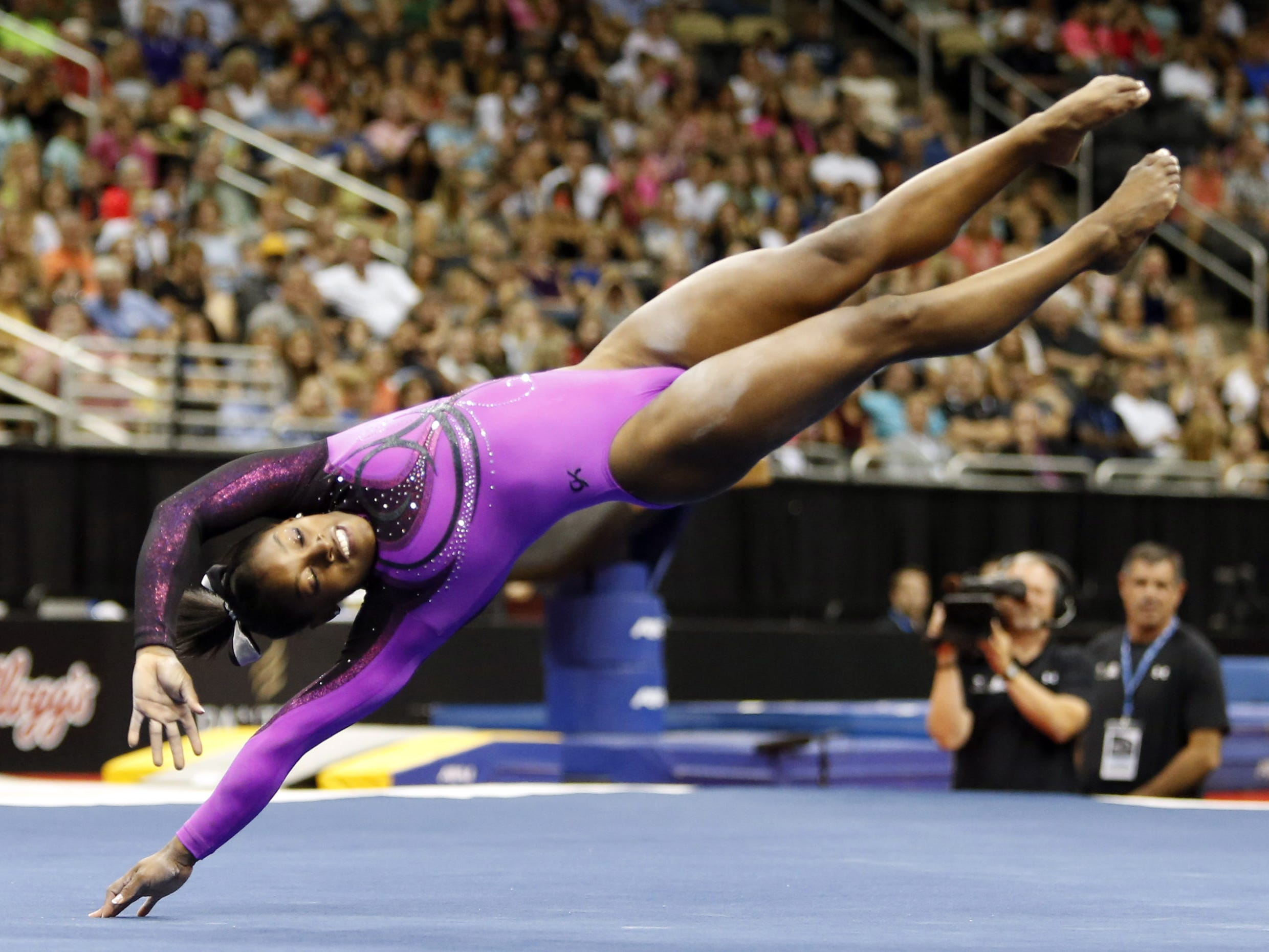 In 2014, Simone Biles competes on the floor exercise portion at the 2014 P&G Championships at the CONSOL Energy Center.