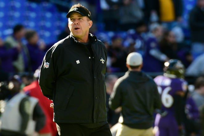 New Orleans Saints head coach Sean Payton watches his team warm up before the game against the Baltimore Ravens at M&T Bank Stadium.