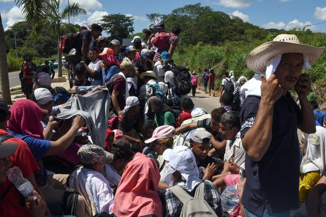 Honduran migrants take part in a caravan heading to the U.S., in the outskirts of Tapachula, on their way to Huixtla, Mexico, on Oct. 22, 2018.