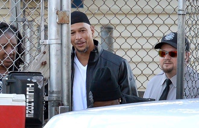 Former Carolina Panthers NFL football player Rae Carruth, center rear, exits the Sampson Correctional Institution in Clinton, N.C., on Oct. 22,. Carruth has been released from prison after serving nearly 19 years for conspiring to murder the mother of his unborn child.
