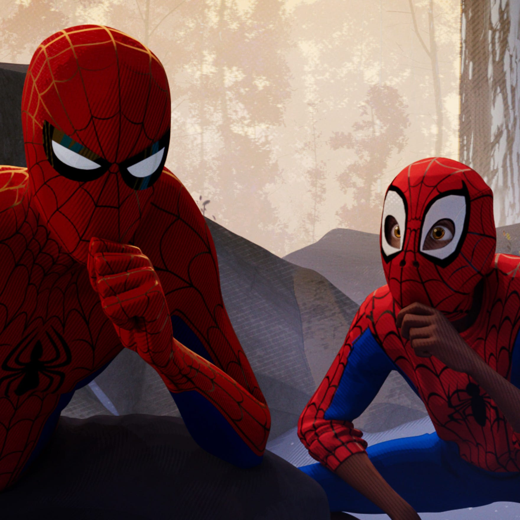 "Peter Parker (Jake Johnson, left) is a heroic role model to Miles Morales (Shameik Moore) in ""Spider-Man: Into the Spider-Verse."""