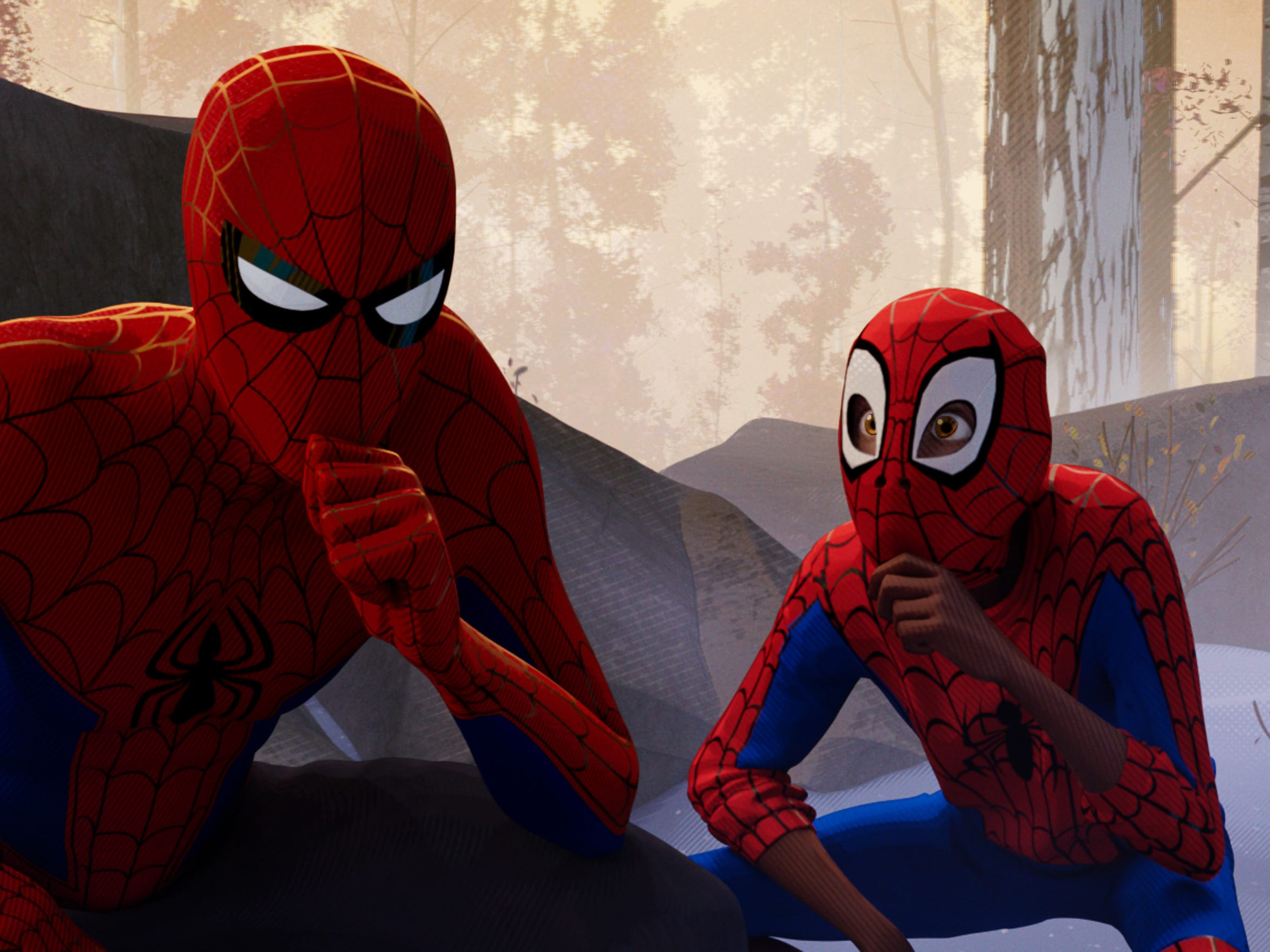 "Peter Parker (voiced by Jake Johnson, left) is a heroic role model to Miles Morales (Shameik Moore) in ""Spider-Man: Into the Spider-Verse."""