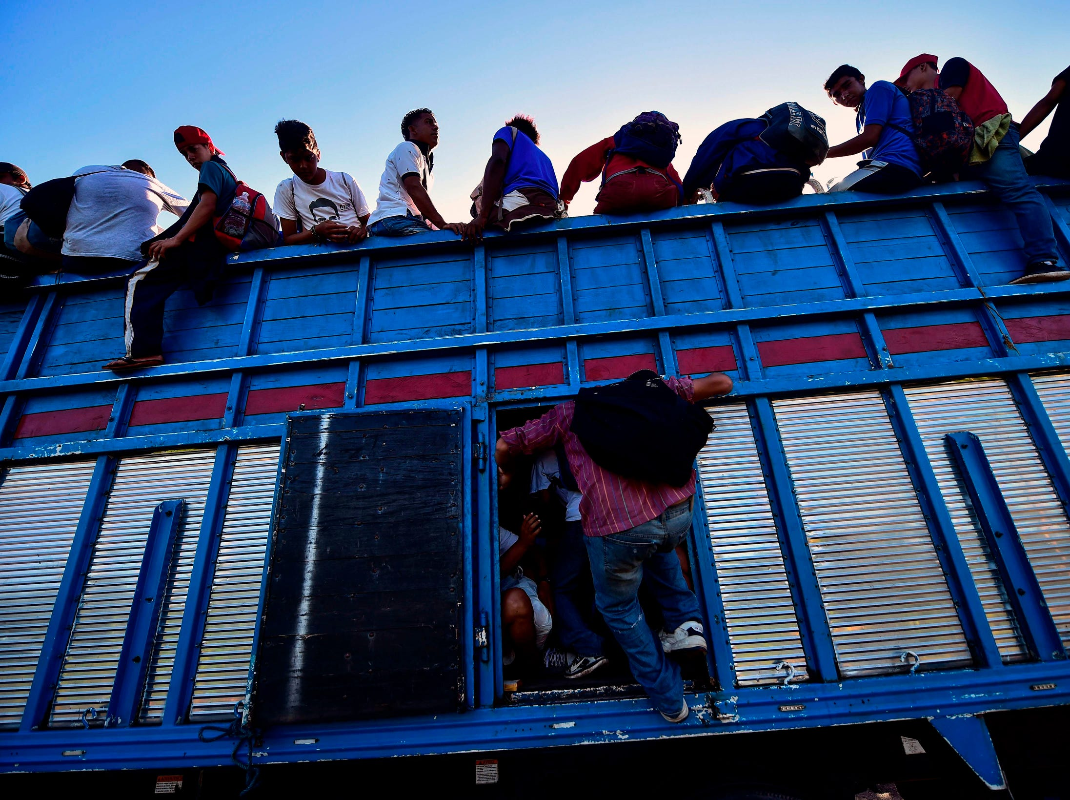 A truck in Metapa takes Honduran migrants on their way to Tapachula, Chiapas state, Mexico.
