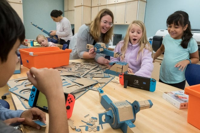 Third-grade students at the Douglass G Grafflin School in Chappaqua, New York, participate in an interactive learning session with the Nintendo Labo: Variety Kit for the Nintendo Switch system, led by Rebecca Rufo-Tepper, Co-Executive Director of the Institute of Play.