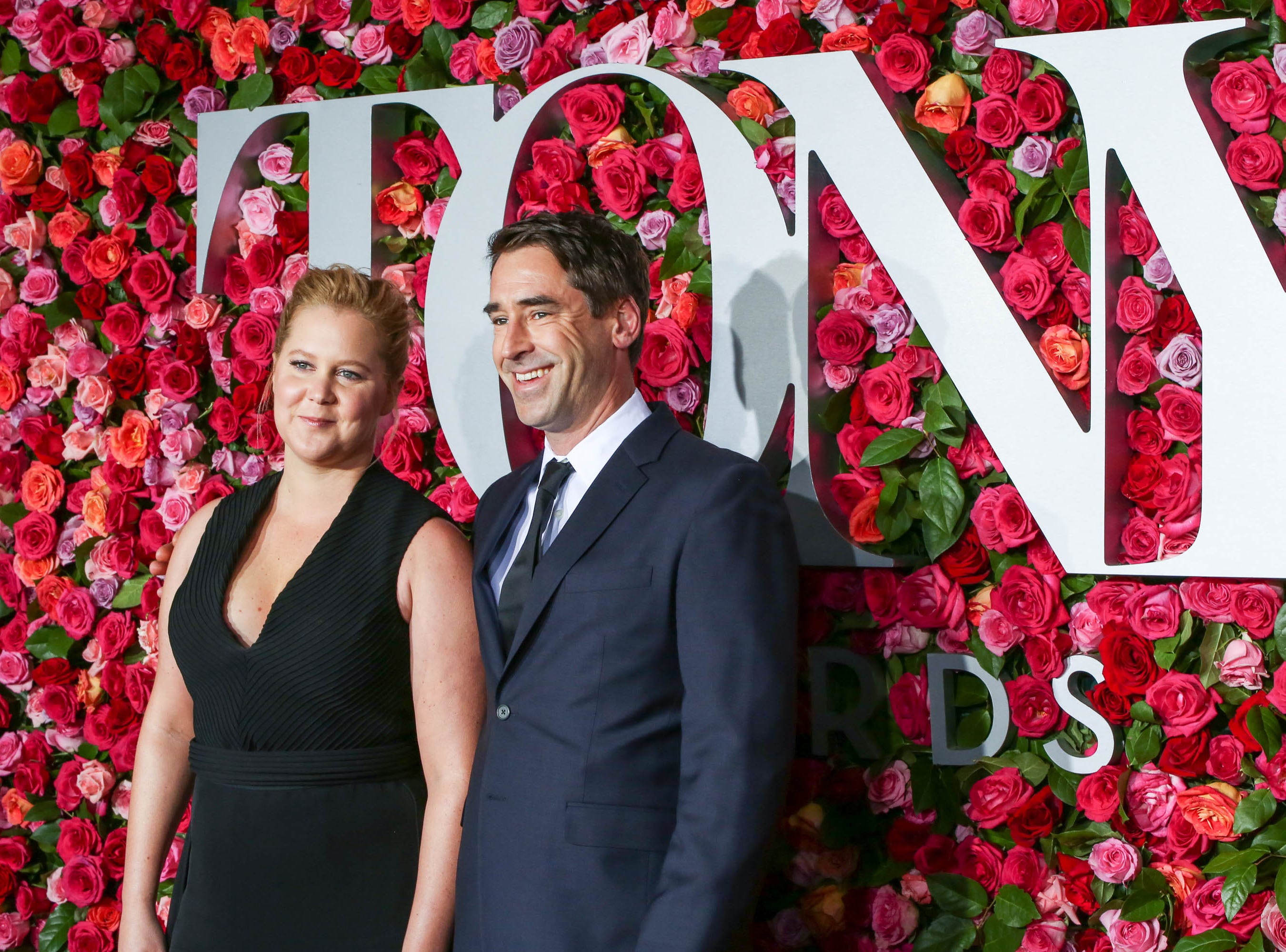 Amy Schumer is pregnant with her first child with husband Chris Fischer