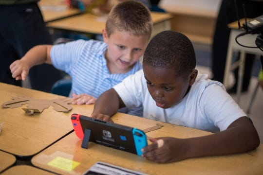 Third-grade students at the Lake Hiawatha Elementary School in Lake Hiawatha, New Jersey, participate in an interactive learning session with the Nintendo Labo: Variety Kit for the Nintendo Switch system.