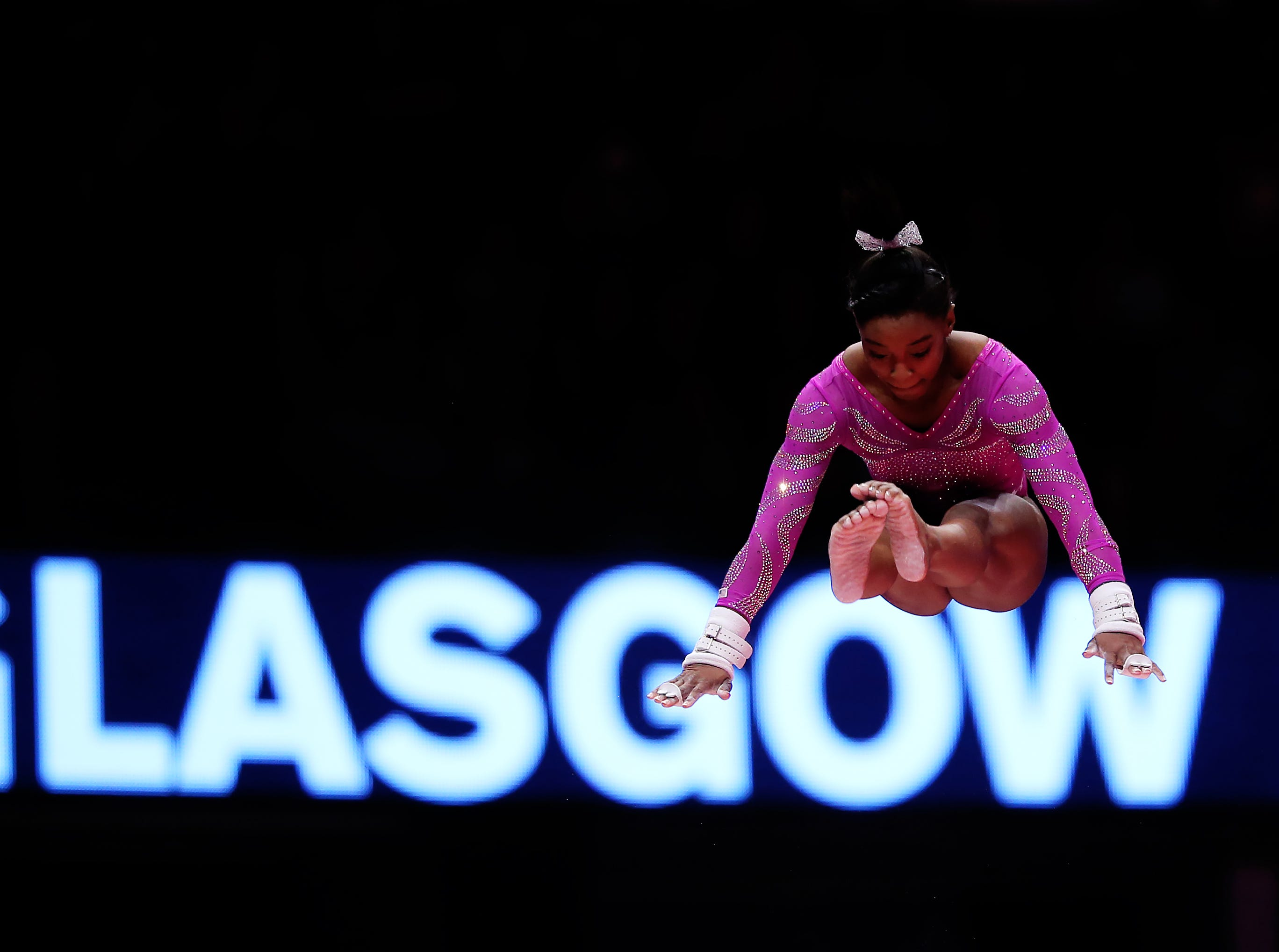 In 2015, Simone Biles competes on the uneven bars during world championships at The SSE Hydro in Glasgow, Scotland.