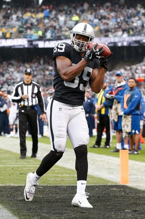 Oakland Raiders wide receiver Amari Cooper (89) catches a touchdown against the Denver Broncos in the second quarter at Oakland Coliseum.